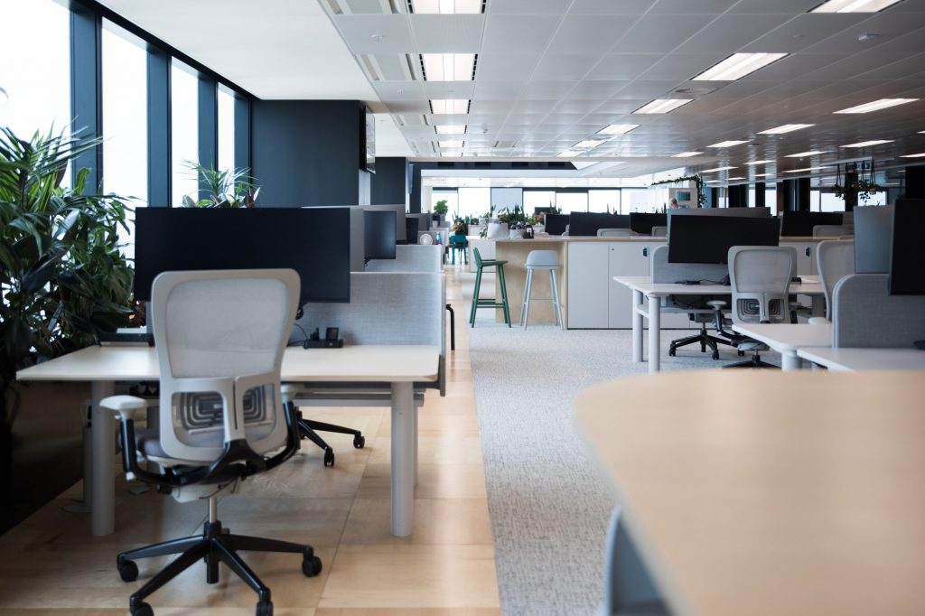 Modern office fitout interior in a commercial building with desks